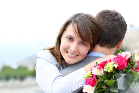 Portrait of cheerful woman who just received flowers photo
