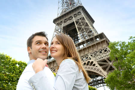Couple embracing each other in front of the Eiffel tower photo