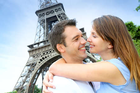 Romantic couple kissing by the Eiffel Tower photo