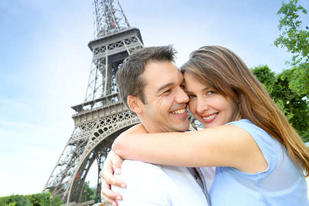Romantic couple kissing by the Eiffel Tower Stock Photo - 14679598