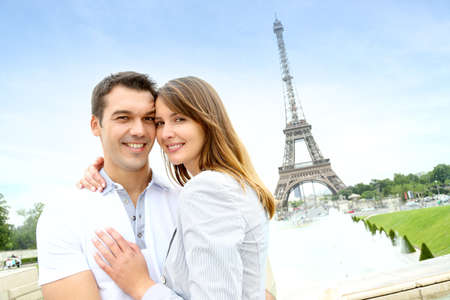 Romantic couple embracing in front of the Eiffel tower Stock Photo - 14693499