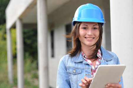Architect on building site working with electronic tablet photo