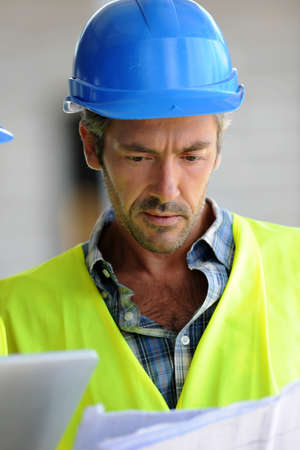 Closeup of construction manager checking plan Stock Photo - 15043129