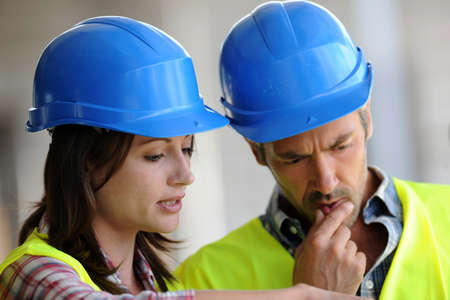 Closeup of construction people with blue security helmet photo