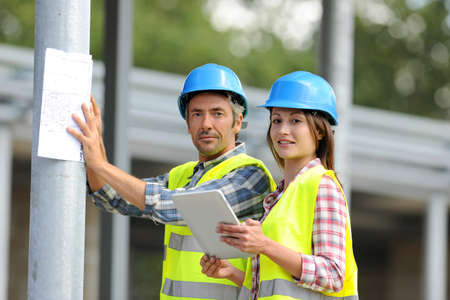 Construction people using electronic tablet on site Stock Photo - 15043019