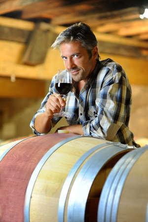 Winemaker tasting red wine in winery Stock Photo - 15088989