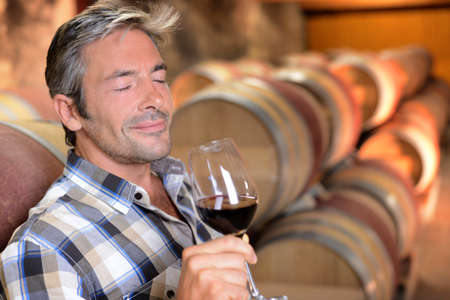 Winemaker enjoying the smell of red wine  photo