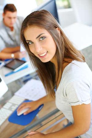 Portrait of beautiful student attending training class photo