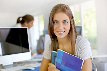 Portrait of smiling student girl in class photo
