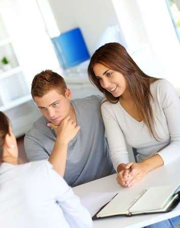 financial consultants: Young couple meeting financial consultant for credit loan