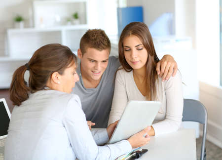financial advisor: Young couple meeting financial consultant for credit loan
