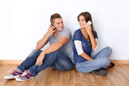 Young couple talking on mobile phone Stock Photo - 15127264