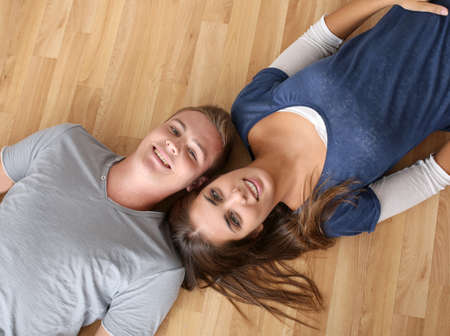 Upper view of young couple laying on the floor photo
