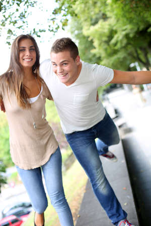 passionate lovers: Friends having fun out in the street Stock Photo