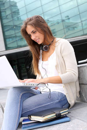 woman stairs: Young girl at university using laptop computer Stock Photo
