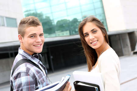classmates: Young couple standing outside university campus