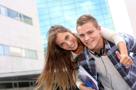 back up: Young guy giving piggyback ride to girlfriend Stock Photo