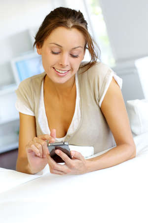hp: Young woman sending short message with telephone Stock Photo