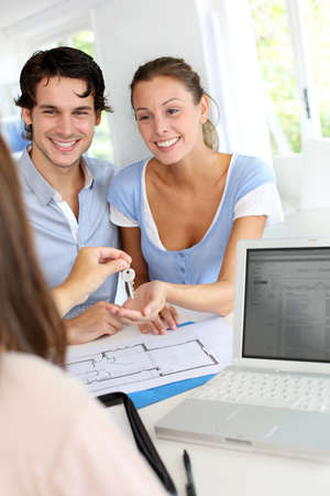 Couple receiving keys of their home Stock Photo - 15279252