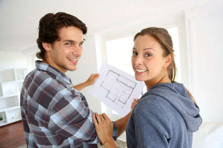 New property owners looking at home blueprint Stock Photo - 15279787