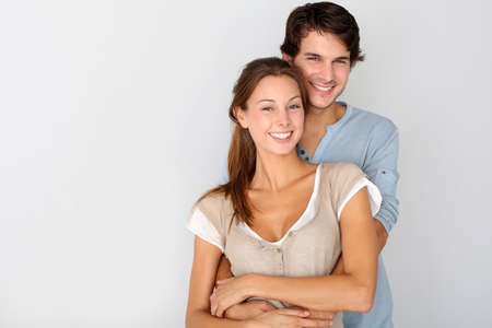 a couple: Cheerful young couple standing on white background, isolated Stock Photo