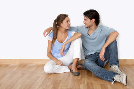 Couple sitting on the floor in new apartment photo