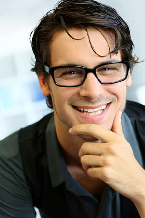 dark glasses: Portrait of handsome young man with glasses Stock Photo