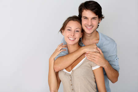 textspace: Cheerful young couple standing on white background, isolated Stock Photo