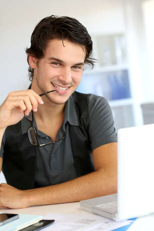 Portrait of young man working in office Stock Photo - 15279243