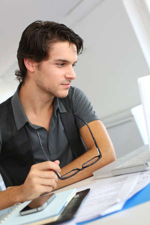 Portrait of young man working in office photo