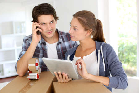 Couple calling transport company to move in new house