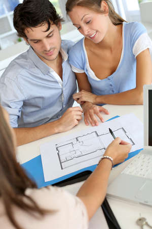estate planning: Couple meeting architect for plans of future home Stock Photo