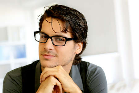 hair black color: Portrait of handsome young man with glasses Stock Photo