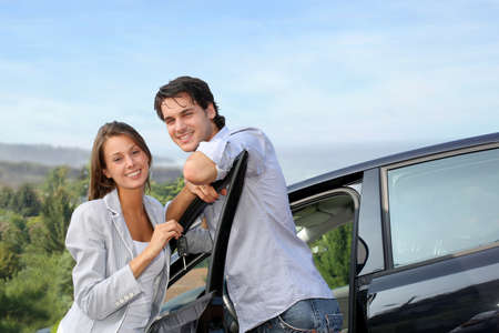 sightseeing tour: Young couple on a week-end trip in car Stock Photo