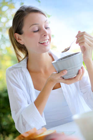 one people: Beautiful woman having cereals for breakfast Stock Photo