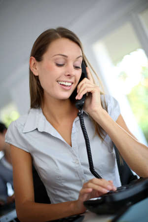 phonecall: Beautiful office worker talking on the phone