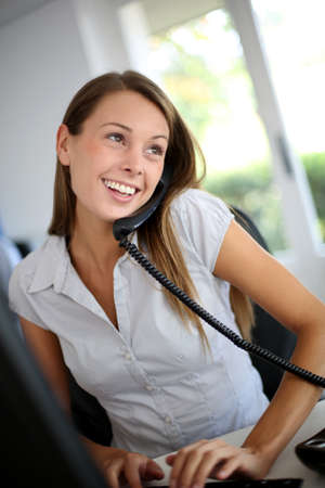telephony: Beautiful office worker talking on the phone