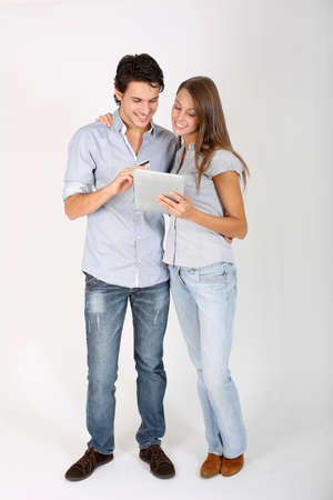 Young couple doing shopping on internet photo