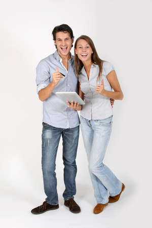 young adults: Young couple doing shopping on internet Stock Photo