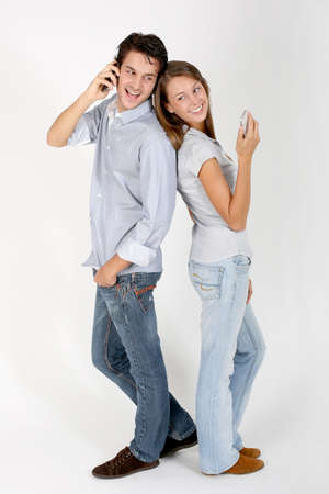 Cheerful couple using smartphone photo