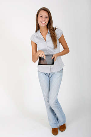 Cheerful girl showing touchpad screen, isolated photo