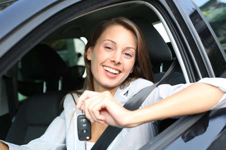 Cheerful girl holding car keys from window Stock Photo - 15290753