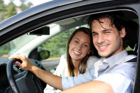 touring car: Cheerful couple driving car