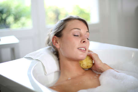 Beautiful woman relaxing in baththub photo
