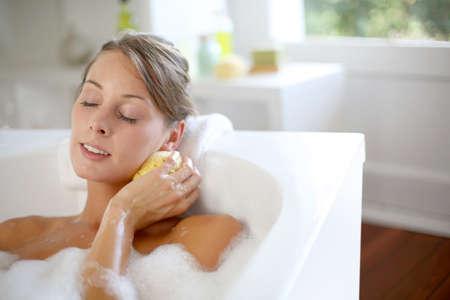 women bathing: Beautiful woman relaxing in baththub