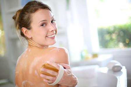 Gorgeous woman scrubbing her back in bath Stock Photo - 15290660