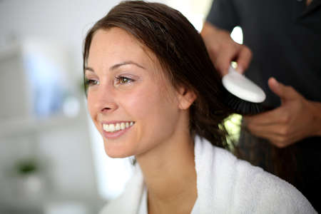 hair brush: Woman having her hair brushed by hairdresser