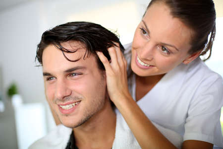 Hairdresser doing head massage to customer Stock Photo - 15290726
