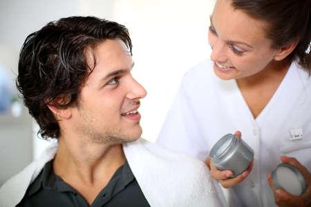 Hairdresser applying hair gel Stock Photo - 15290719