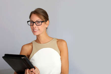 Portrait of charming businesswoman with eyeglasses photo